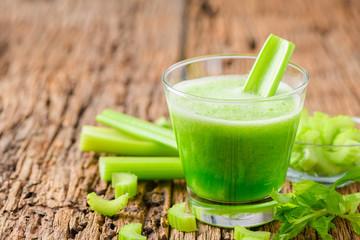 Fresh green celery juice in glass