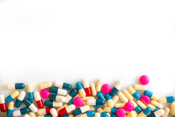 Colorful pills and medication on white background with copy space, health and medication concept