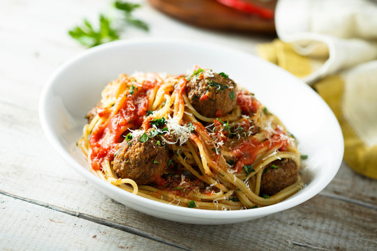Homemade pasta with meatballs and tomato sauce