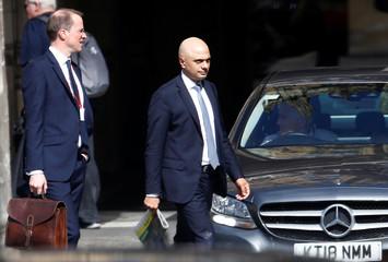 Britain's Home Secretary Sajid Javid walks near the Parliament grounds in London