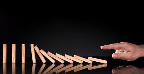 Domino Effect Concept on black background