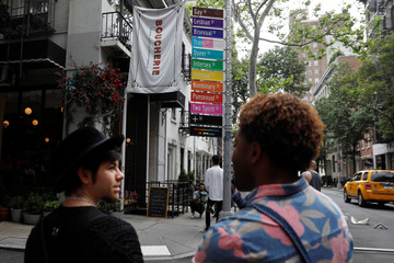 LGBTQ street signs are placed under Gay Street themed as Acceptance Street as to coincide with the 50th anniversary of the 1969 Stonewall uprising, considered the birth of the LGBT movement in New York City