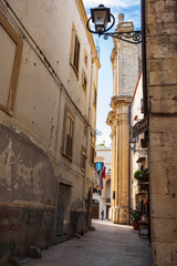 Typical picturesque narrow street in the Old Town of Bari, Puglia region, Southern Italy.