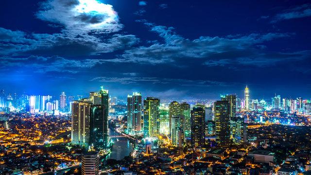 Rising Moon over the skyline of Metro Manila