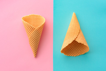 Ice cream waffle cones on pastel pink and blue background