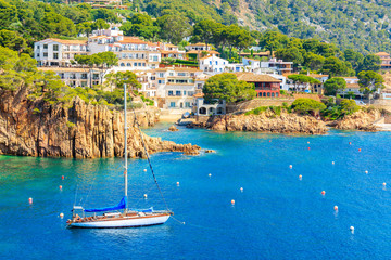 Wall Mural - Sailing boats on sea in picturesque bay near Fornells village, Costa Brava, Spain