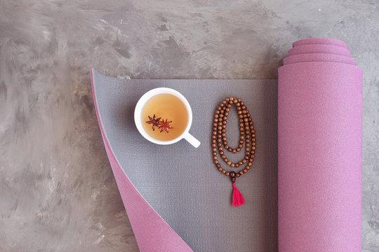 Yoga mat, mala beads and Ayurveda tea for relax yoga practice y meditation.
