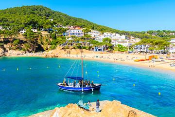 Wall Mural - TAMARIU, SPAIN - JUN 2, 2019: Boat with divers sailing in beautiful bay near fishing village of Tamariu, Costa Brava, Spain.