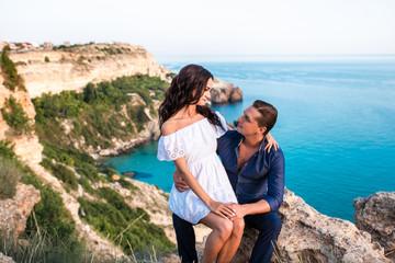 Printed kitchen splashbacks Artist KB Romantic couple on the rock near beautiful sea beach.
