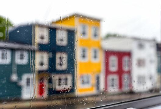 Rain drops on windows with jellybean houses in St. John's, Newfoundland