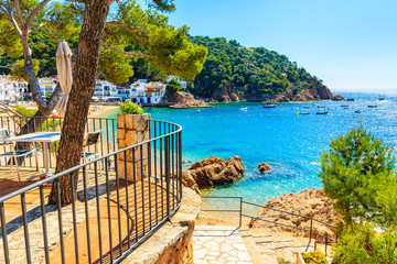 Fototapete - Steps to sandy beach and sea bay in Tamariu seaside town, Costa Brava, Spain