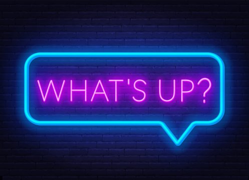 Neon sign what's up in speech bubble frame on dark background. Light banner on the wall background.