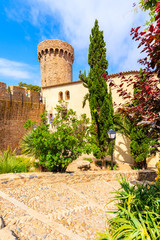 Fototapete - Castle tower and gardens in old town of Tossa de Mar, Costa Brava, Spain