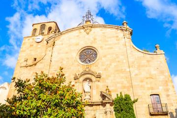 Wall Mural - Facade of old church in Tossa de Mar town, Costa Brava, Spain