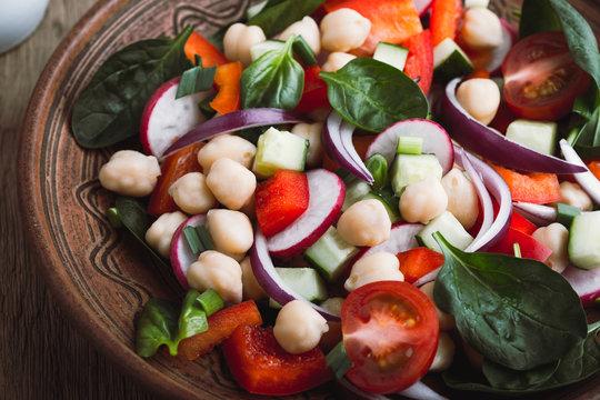 Healthy  vegan salad, chickpeas and  fresh vegetables