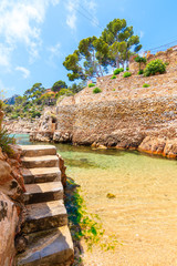 Fototapete - Steps to beach and holiday apartments in Fornells village, Costa Brava, Spain