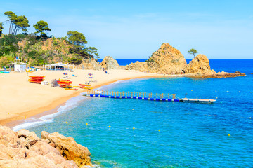 Fototapete - Azure blue water on idyllic beach in Tossa de Mar town, Costa Brava, Spain