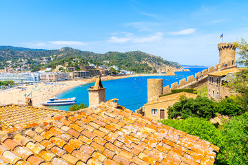Wall Mural - View of sandy beach and bay in Tossa de Mar town from castle walls, Costa Brava, Spain