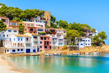View of colorful houses in sea bay with beach in Sa Tuna coastal village, Costa Brava, Spain Fototapete
