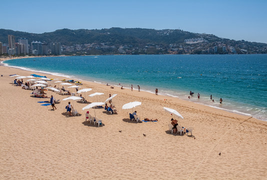 Acapulco, beach with white sand and blue ocean