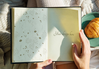 Person Holding a Book Mockup