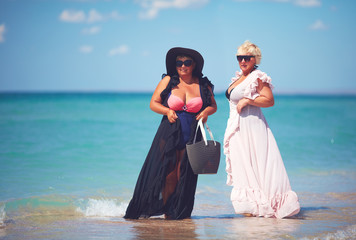 happy plus suze, adult women enjoy summer vacation at the beach