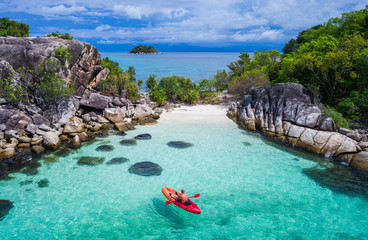 Aerial drone view of in kayak in crystal clear lagoon sea water during summer day near Koh Lipe island in Thailand. Travel tropical island holiday concept Fototapete