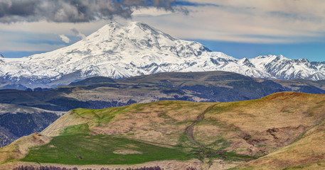 Panoramic view of Elbrus mountain in spring time.