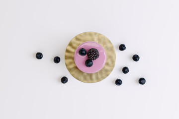 Fotobehang Zuivelproducten berry muffin with blackberries on a white background