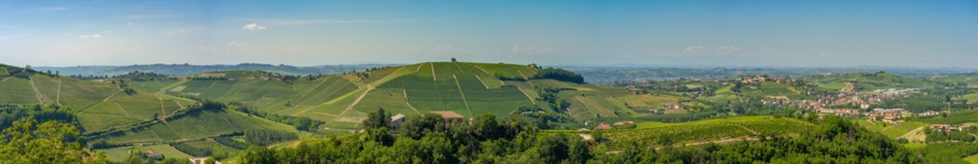 Castiglione Tinella town, wide panoramic view of Vineyards with blue sky, Langhe, Roero and Monferrato wine region, Italy