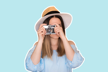 Portrait of a smiling young woman in summer hat standing with photo camera over blue background. Cartoon social network stickers