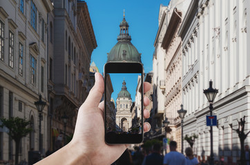 Wall Mural - Hand taking photo of famous landmark and travel destination in Budapest, Hungary by mobile smart phone