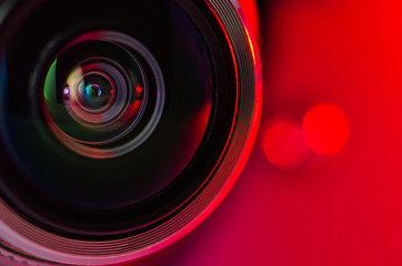 The camera lens and red backlighting . Horizontal photo