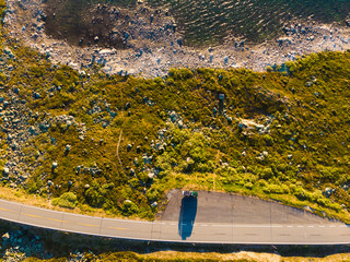Top down view. Camper car on road, Hardangervidda plateau, Norway