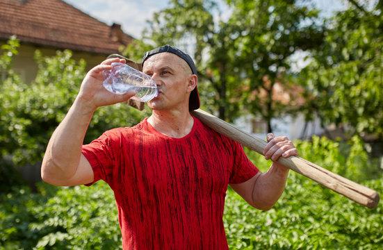 Farmer drinking water