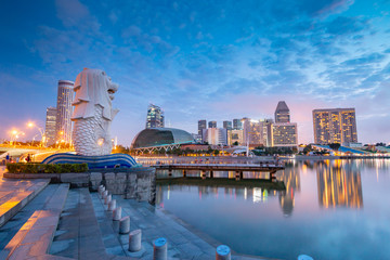 the Merlion statue fountain, iconic symbol of Singapore, overlooking the Marina Bay waterfront, the Esplanade Theatres, luxury hotels