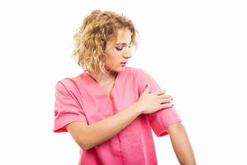 Portrait of nurse wearing pink scrub arranging sleeve