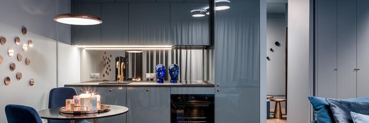 Fototapeta Blue apartment with open kitchen obraz