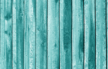 Old grungy wooden planks background in cyan tone.