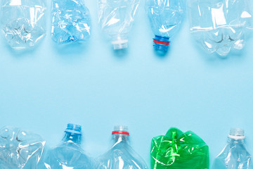 Single use plastic bottles with copy space top view