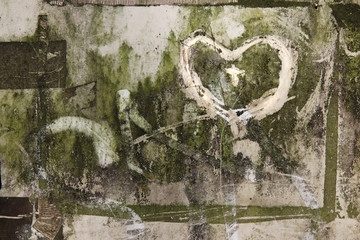Hearts scribbled on a very dirty surface