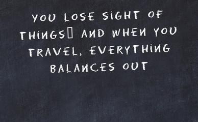 Black chalkboard with handwritten wise motivational quote