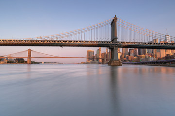 In de dag Brug East riVer View at sunrise with Dumbo, Manhattan Bridge, Brooklyn bridge and Financial District with long exposure photo