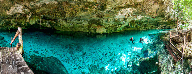 Cenote Dos Ojos - Cave Two Eyes - in Mexico, peninsula Yucatan with sparkling clear turquoise water and warm water