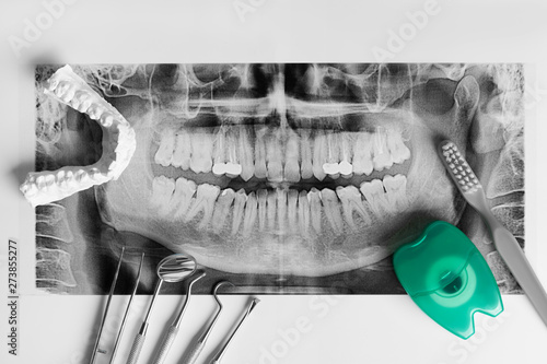Wall mural dental tools on white background with x rey top view