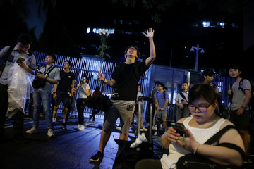 Faithful sing religious songs outside the Legislative Council building as they protest a proposed extradition bill with China in Hong Kong