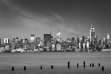 Wall Mural - New York skyline illuminated at night, view from Jersey City