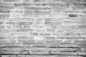 Very old grunge white and gray tone brick wall background