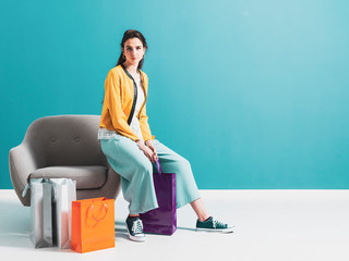 Wall Mural - Young woman with shopping bags