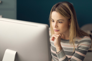Young attractive woman working with a computer